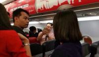 【中英双语】中国游客大闹亚航被严惩,国外网民怎么看?